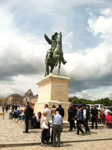 The statue of Louis XIV greets the visitor as you enter the property of the Palace of Versailles,