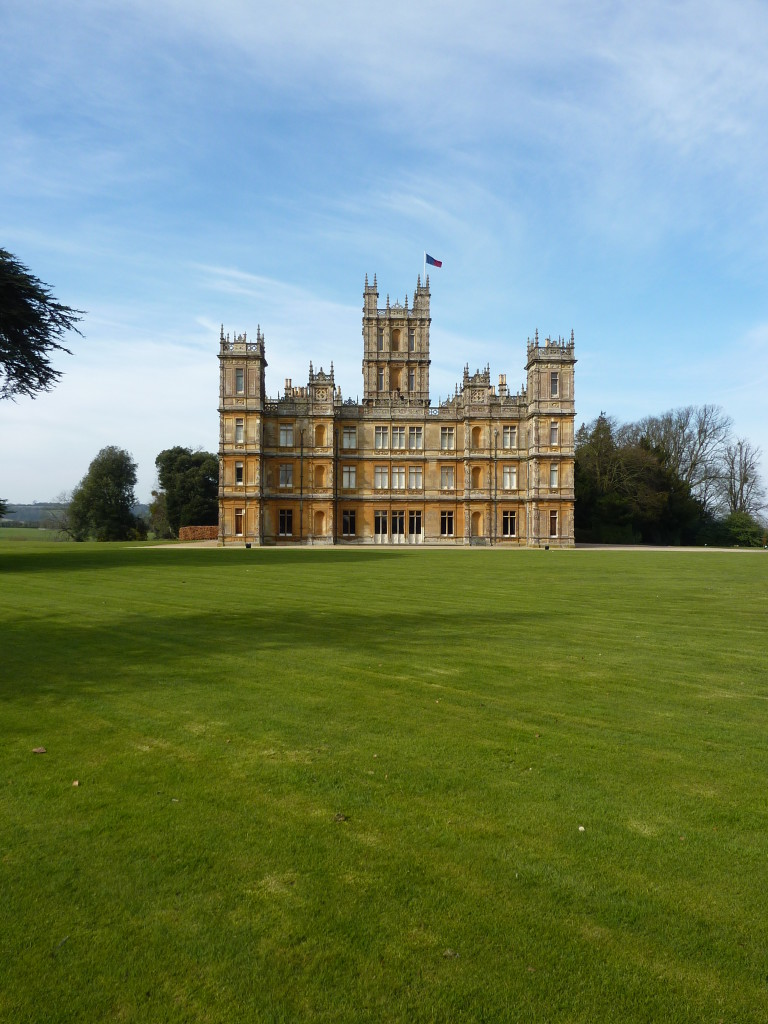 'Downton Abbey' [Highclere Castle]  with its lawn that stretches to the walls of the house.