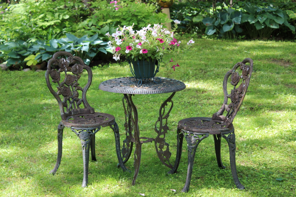 This cast iron table and chairs decorate my back garden.