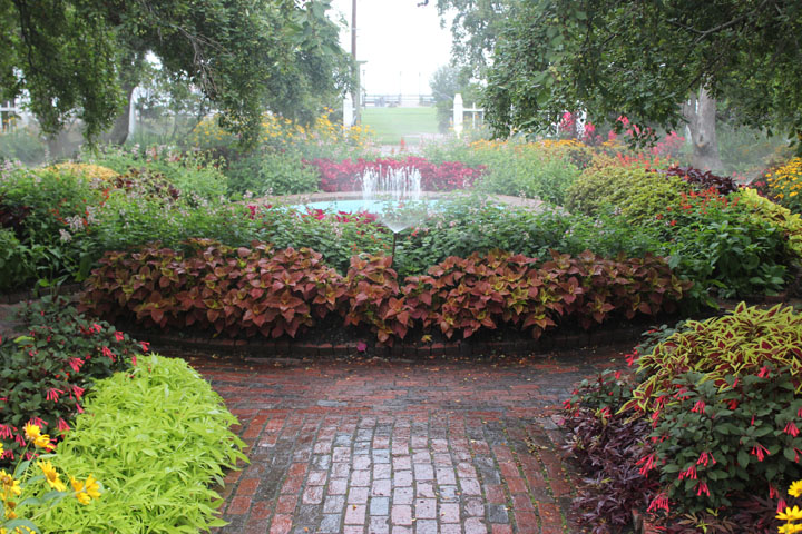 The garden and foundtain at Prescott Park, with the waterfront in the back