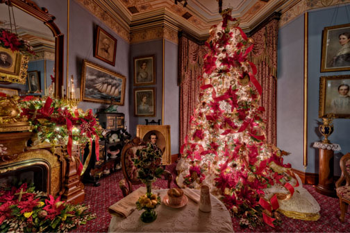 """Revelry in Red and Gold"" theme for this Christmas tree at the Fall River Historical Society"